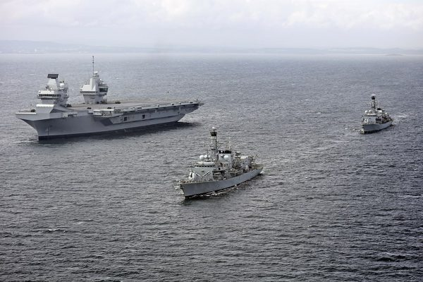 HMS Queen Elizabeth with HMS Sutherland and HMS Iron Duke photo UK Ministry of Defence