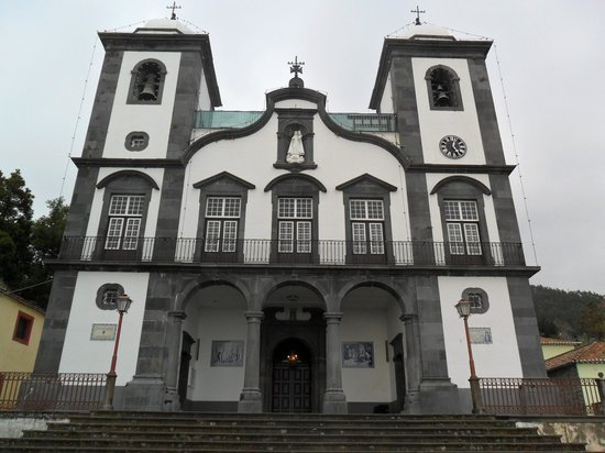 Baroque, twin towered facade of Our Lady of Monte Church, Madeira (1818) featuring black local stonework and white render